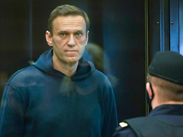 Handout photo provided by Moscow City Court Russian opposition leader Alexei Navalny stands in the cage during a hearing to a motion from the Russian prison service to convert the suspended sentence of Navalny from the 2014 criminal conviction. PTI