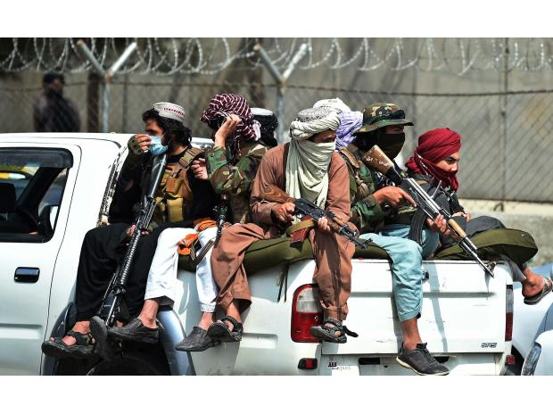 Taliban fighters guard outside the airport in Kabul on Aug. 31.